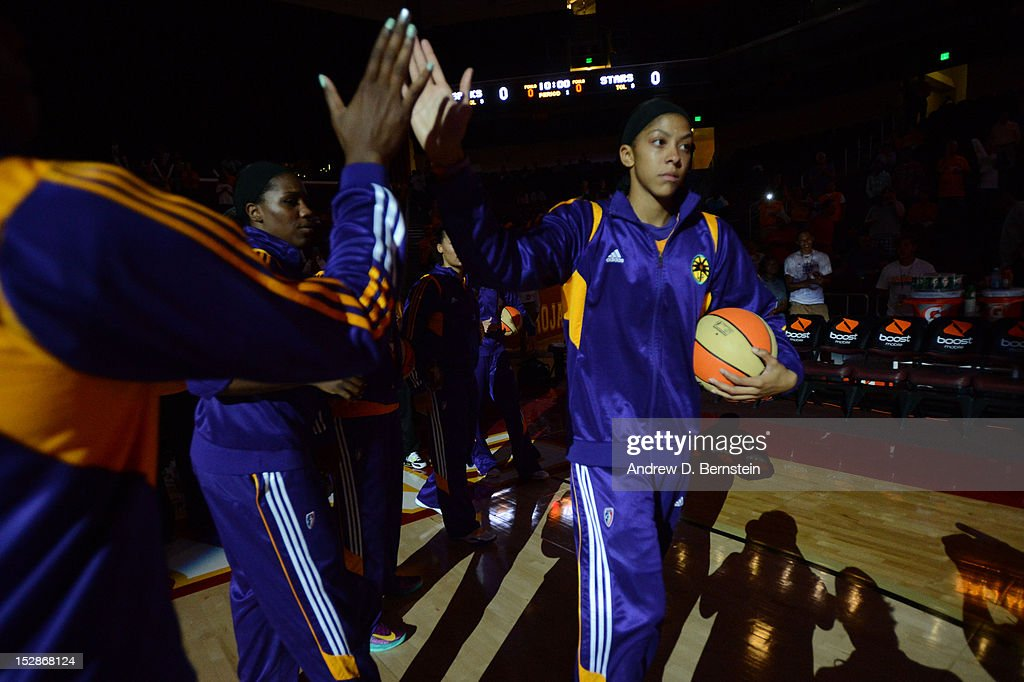 <a gi-track='captionPersonalityLinkClicked' href=/galleries/search?phrase=Candace+Parker&family=editorial&specificpeople=752955 ng-click='$event.stopPropagation()'>Candace Parker</a> #3 of the Los Angeles Sparks high fives a teammate during introductions prior to a game against the San Antonio Stars in Game 1 of the WNBA Western Conference Semi Finals at Galen Center on September 27, 2012 in Los Angeles, California.