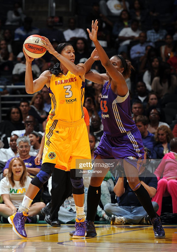 Candace Parker of the Los Angeles Sparks is defended by Nakia Sanford of the Phoenix Mercury at Staples Center on June 8 2012 in Los Angeles...