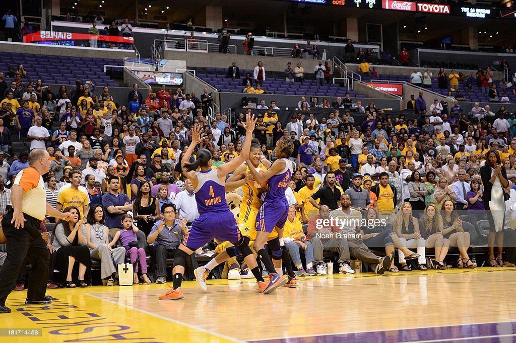 <a gi-track='captionPersonalityLinkClicked' href=/galleries/search?phrase=Candace+Parker&family=editorial&specificpeople=752955 ng-click='$event.stopPropagation()'>Candace Parker</a> #3 of the Los Angeles Sparks is guarded while trying to get off a shot against the Phoenix Mercury at the end of Game Three of the Western Conference Semifinal of the 2013 WNBA playoffs at Staples Center on September 23, 2013 in Los Angeles, California.