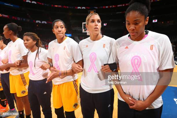 Candace Parker of the Los Angeles Sparks locks arms with Elena Delle Donne of the Washington Mystics during the national anthem on August 16 2017 at...