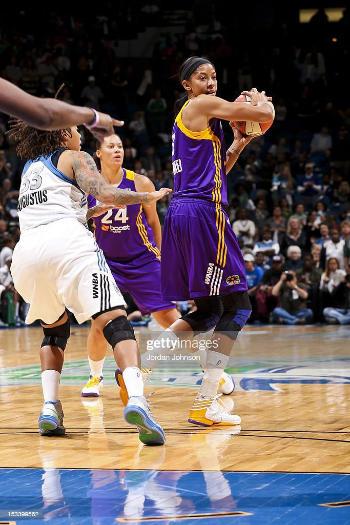 Candace Parker #3 of the Los Angeles Sparks looks to pass the ball against Seimone Augustus #33 of the Minnesota Lynx during Game One of the 2012 WNBA Western Conference Finals on October 4, 2012 at Target Center in Minneapolis, Minnesota.