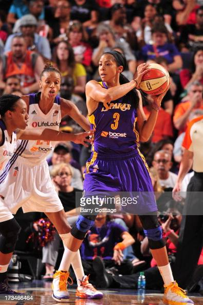 Candace Parker of the Los Angeles Sparks looks to pass the ball against DeWanna Bonner and Alexis Hornbuckle of the Phoenix Mercury on July 14 2013...