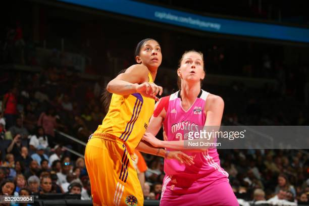 Candace Parker of the Los Angeles Sparks plays defense against Emma Meesseman of the Washington Mystics on August 16 2017 at the Verizon Center in...