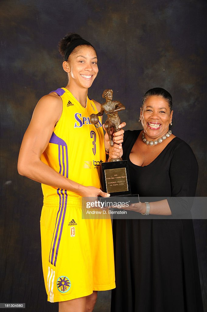 Candace Parker #3 of the Los Angeles Sparks poses with her trophy for being awarded the WNBA's Most Valuable Player for the 2013 season at STAPLES Center on September 19, 2013 in Los Angeles, California.