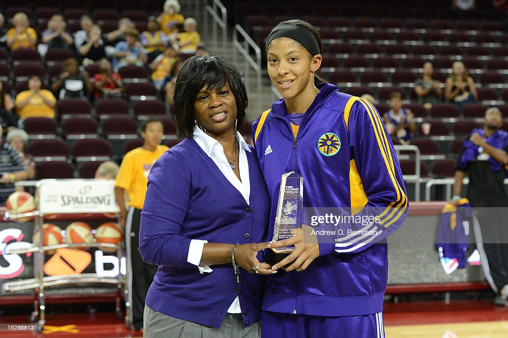 <a gi-track='captionPersonalityLinkClicked' href=/galleries/search?phrase=Candace+Parker&family=editorial&specificpeople=752955 ng-click='$event.stopPropagation()'>Candace Parker</a> #3 of the Los Angeles Sparks poses with Penny Toler after receiving her award for Western Conference player of the month prior to a game against the San Antonio Stars in Game 1 of the WNBA Western Conference Semi Finals at Galen Center on September 27, 2012 in Los Angeles, California.