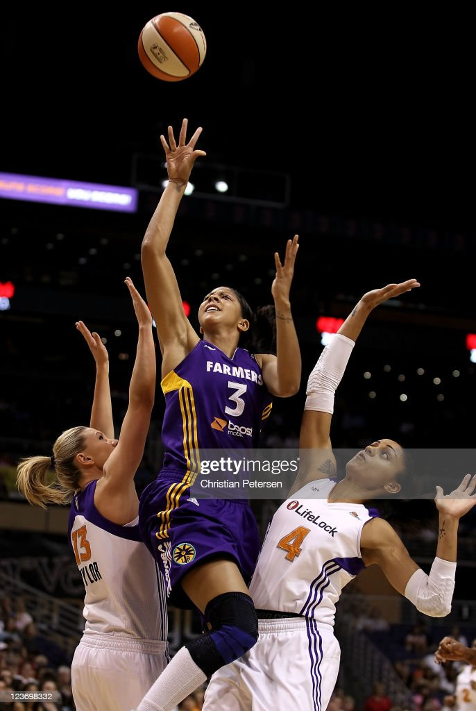 <a gi-track='captionPersonalityLinkClicked' href=/galleries/search?phrase=Candace+Parker&family=editorial&specificpeople=752955 ng-click='$event.stopPropagation()'>Candace Parker</a> #3 of the Los Angeles Sparks puts up a shot between <a gi-track='captionPersonalityLinkClicked' href=/galleries/search?phrase=Penny+Taylor&family=editorial&specificpeople=206985 ng-click='$event.stopPropagation()'>Penny Taylor</a> #13 and <a gi-track='captionPersonalityLinkClicked' href=/galleries/search?phrase=Candice+Dupree&family=editorial&specificpeople=537818 ng-click='$event.stopPropagation()'>Candice Dupree</a> #4 of the Phoenix Mercury during the WNBA game at US Airways Center on September 3, 2011 in Phoenix, Arizona.