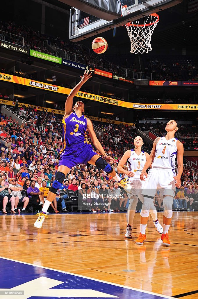 <a gi-track='captionPersonalityLinkClicked' href=/galleries/search?phrase=Candace+Parker&family=editorial&specificpeople=752955 ng-click='$event.stopPropagation()'>Candace Parker</a> #3 of the Los Angeles Sparks shoots against <a gi-track='captionPersonalityLinkClicked' href=/galleries/search?phrase=Candice+Dupree&family=editorial&specificpeople=537818 ng-click='$event.stopPropagation()'>Candice Dupree</a> #4 of the Phoenix Mercury in Game 2 Round 1 of the 2013 WNBA Playoffs on September 13, 2013 at U.S. Airways Center in Phoenix, Arizona.