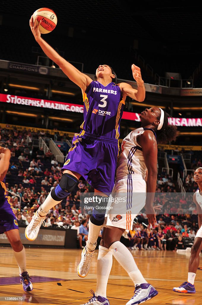 Candace Parker of the Los Angeles Sparks shoots against Nakia Sanford of the Phoenix Mercury on September 3 2011 at US Airways Center in Phoenix...