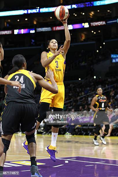 Candace Parker of the Los Angeles Sparks shoots against Vicki Baugh of the Tulsa Shock in a WNBA game at Staples Center on September 6 2015 in Los...