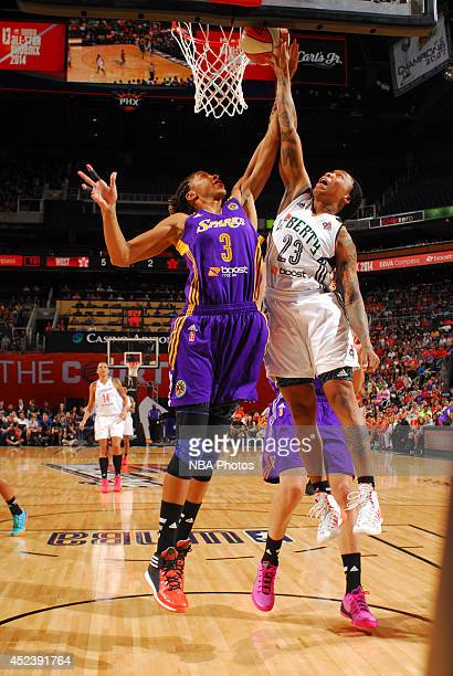 Candace Parker of the Western Conference AllStars rebounds against Cappie Pondexter of the Eastern Conference AllStars during the 2014 Boost Mobile...