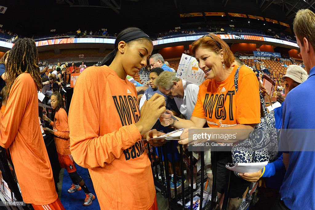 Candace Parker #3 of the Western Conference All-Stars signs an autograph during the 2013 Boost Mobile WNBA All-Star Game on July 27, 2013 at Mohegan Sun Arena in Uncasville, Connecticut.