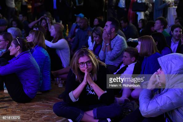 Candace Taylor middle looks stunned as she and others watch numbers continue to turn in favor of Republican candidate Donald Trump and against...