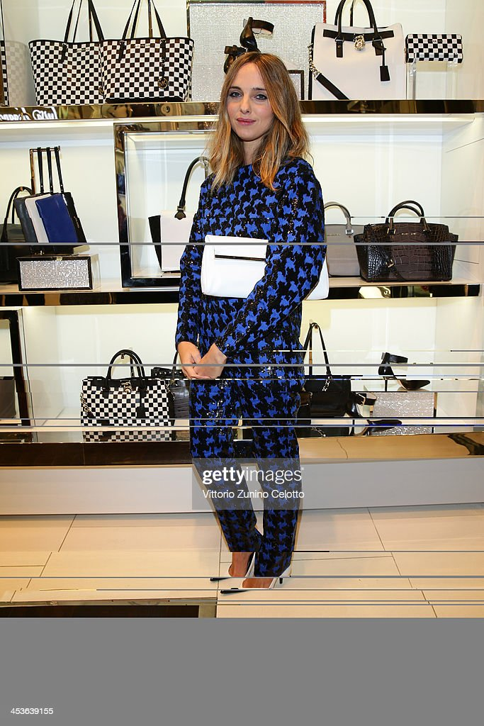 <a gi-track='captionPersonalityLinkClicked' href=/galleries/search?phrase=Candela+Novembre&family=editorial&specificpeople=8618931 ng-click='$event.stopPropagation()'>Candela Novembre</a> attends Michael Kors To celebrate Milano opening on December 4, 2013 in Milan, Italy.