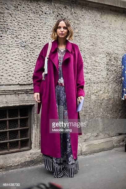 Candela Novembre attends the Fay show in a Blumarine coat Alberta Ferretti dress Jimmy Choo shoes and Sara Battaglia bag on February 25 2015 in Milan...