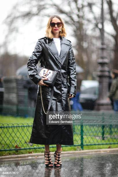 Candela Novembre is wearing a black trench coat a Louis Vuitton bag sunglasses and heels outside the Elie Saab show during Paris Fashion Week...