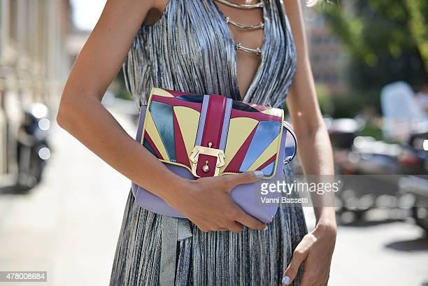 Candela Novembre poses wearing A Philipp Plein dress and Paula Cademartori bag on June 21 2015 in Milan Italy