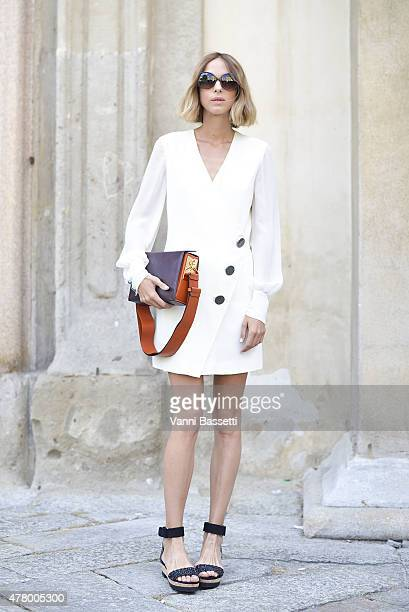 Candela Novembre poses wearing a Redemption Choppers dress and Marni bag on June 21 2015 in Milan Italy
