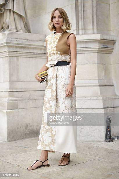Candela Novembre poses wearing a Stella McCartney dress before the Alexis Mabille presentation at the Opera Garnier on July 8 2015 in Paris France