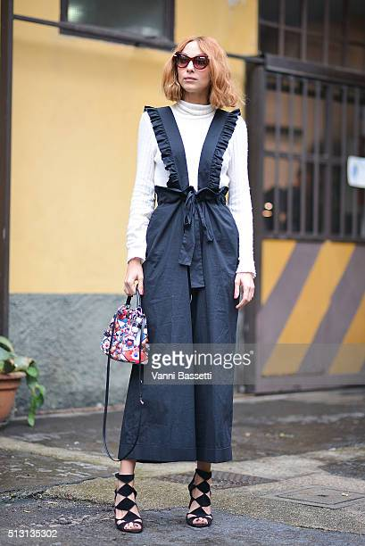 Candela Novembre poses wearing a Vivetta dress and a Fendi bag before the Arthur Arbesser show during the Milan Fashion Week Fall/Winter 2016/17 on...