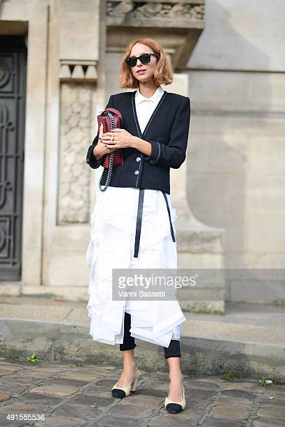 Candela Novembre poses wearing Chanel before the Chanel show at the Grand Palais during Paris Fashion Week SS16 on October 6 2015 in Paris France