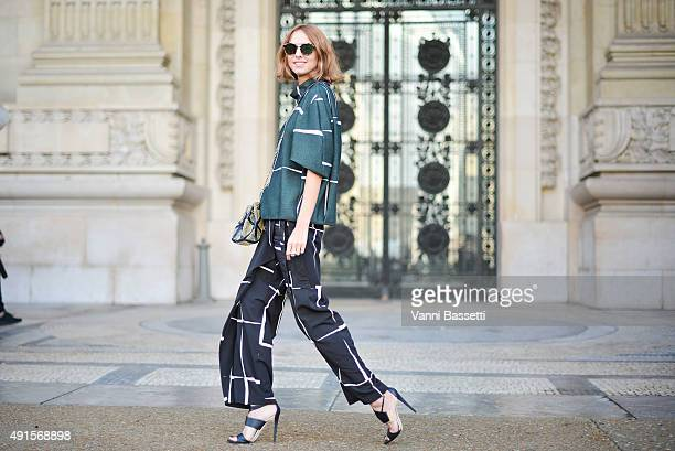 Candela Novembre poses wearing Mila Schon before the Shiatzy Chen show at the Grand Palais during Paris Fashion Week SS16 on October 6 2015 in Paris...