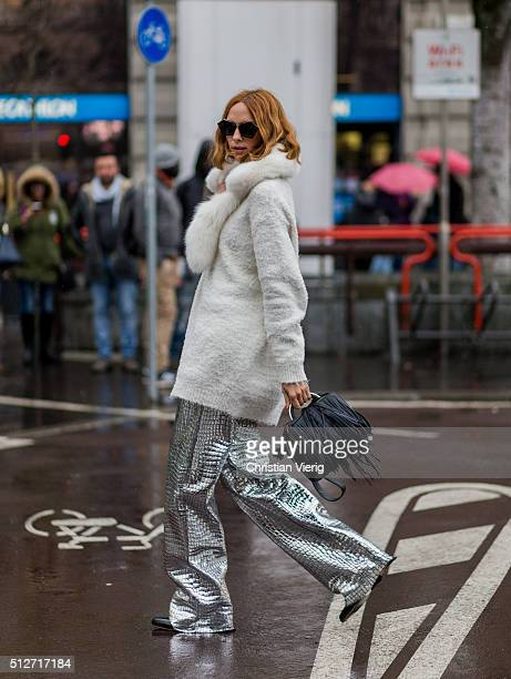 Candela Novembre wearing a creme sweater and fur scarf and a silver pants seen outside Jil Sander during Milan Fashion Week Fall/Winter 2016/17 on...