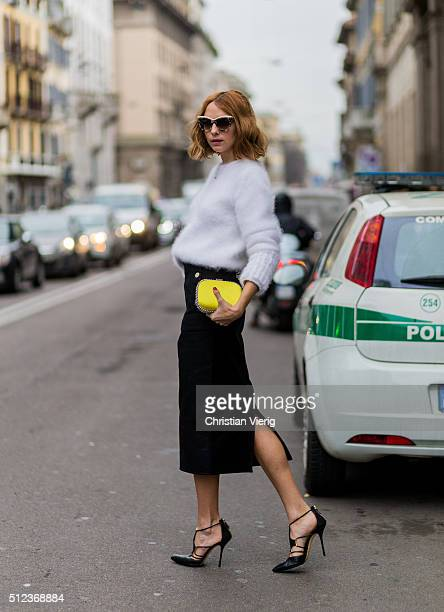 Candela Novembre wearing a white Fendi sweater a yellow Stella McCartney clutch a black Max Mara skirt seen outside Max Mara during Milan Fashion...