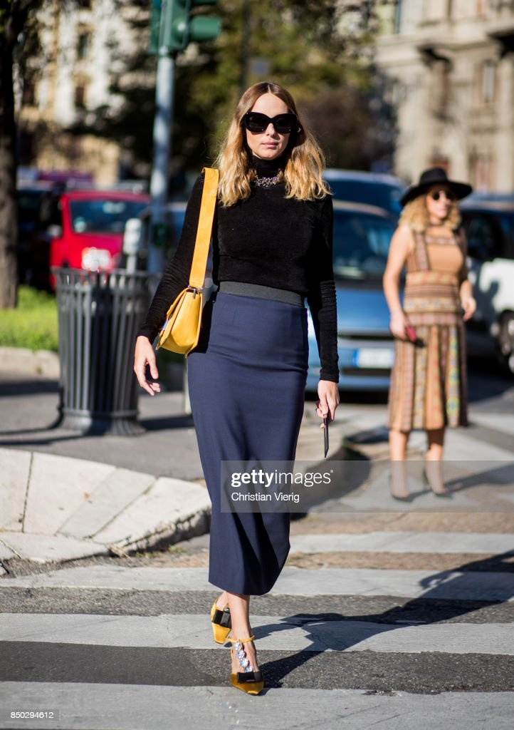 Candela Novembre wearing navy skit, yellow bag, longshirt is seen outside Alberta Ferretti during Milan Fashion Week Spring/Summer 2018 on September 20, 2017 in Milan, Italy.