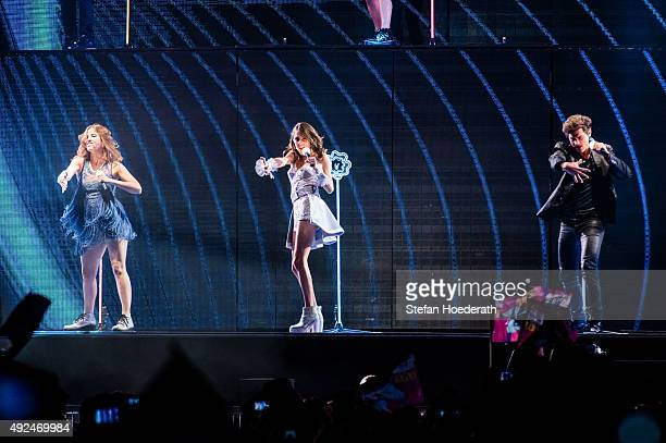 Candelaria Molfese aka Camila Martina Stoessel aka Violetta and Diego Dominguez perform live on stage during Violetta Live at MercedesBenz Arena on...