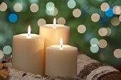 candels on cedar logs