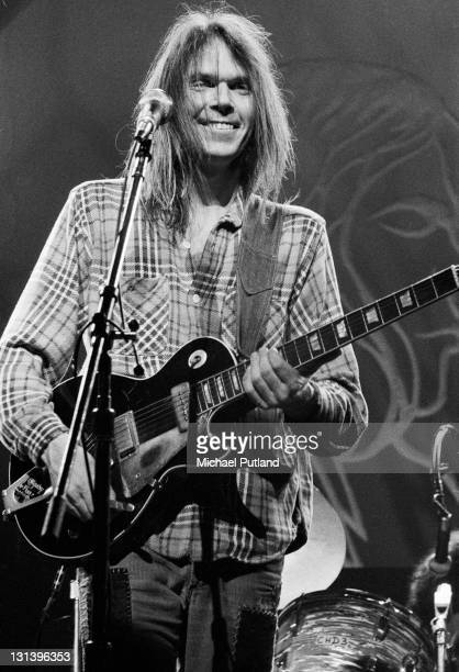 Candian singersongwriter Neil Young performs on stage at Hammersmith Odeon London 28th March 1976 He plays a Gibson Les Paul guitar with Bisgby...