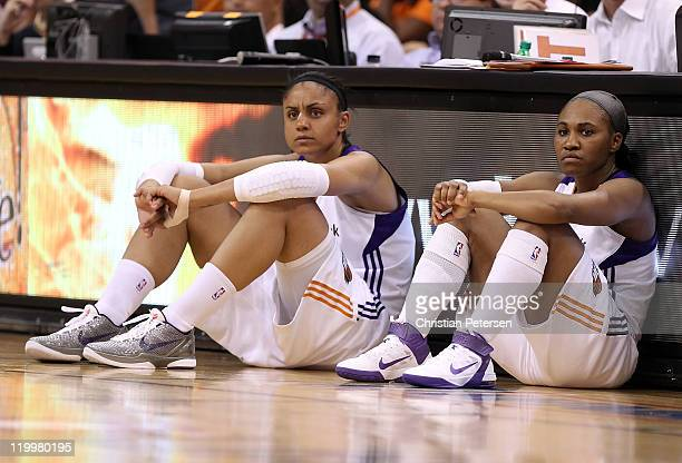 Candice Dupree and Temeka Johnson of the Phoenix Mercury wait to check in during the WNBA game against the Seattle Storm at US Airways Center on July...