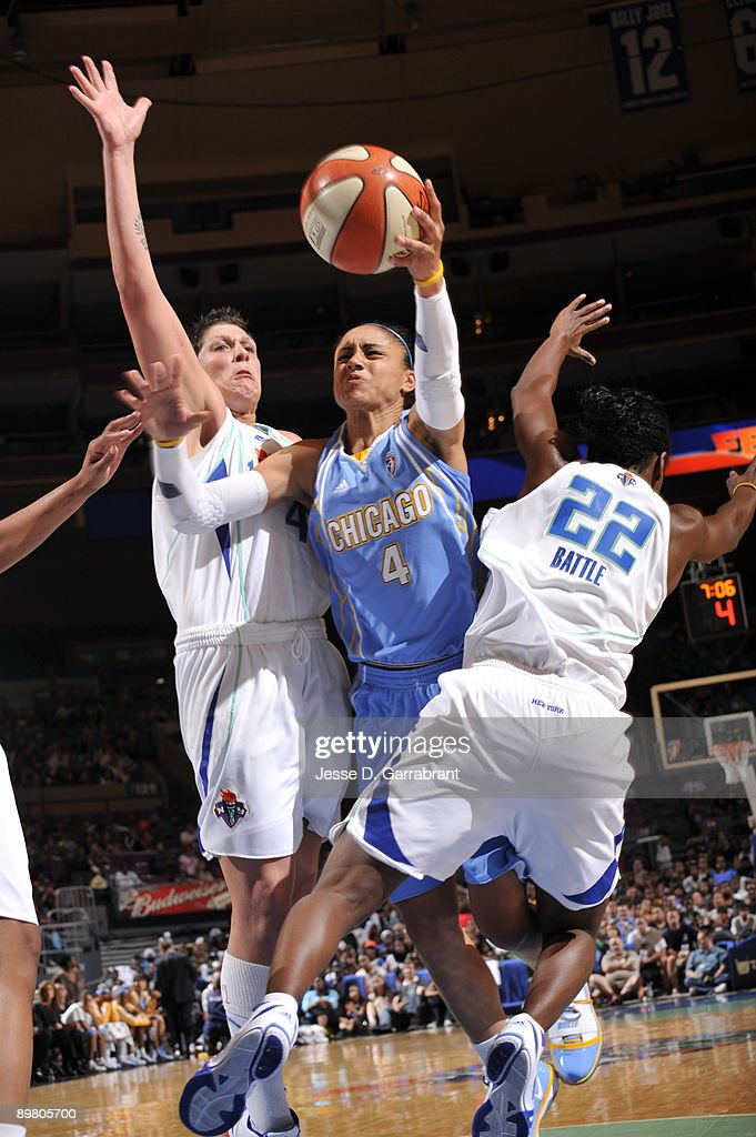 Candice Dupree of the Chicago Sky goes up for a shot against Janel McCarville of the New York Liberty on August 14 2009 at Madison Square Garden in...