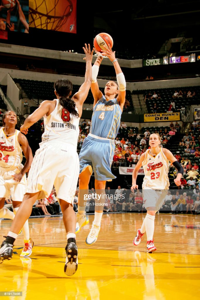Candice Dupree of the Chicago Sky shoots over Tammy SuttonBrown of the Indiana Fever at Conseco Fieldhouse on July 12 2008 in Indianapolis Indiana...