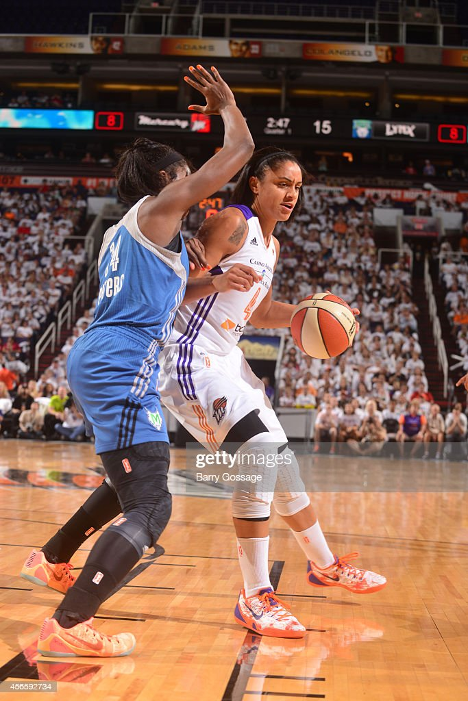 Candice Dupree #4 of the Phoenix Mercury drives against the Minnesota Lynx in Game 1 of the 2014 WNBA Western Conference Finals on August 29, 2014 at US Airways Center in Phoenix, Arizona.