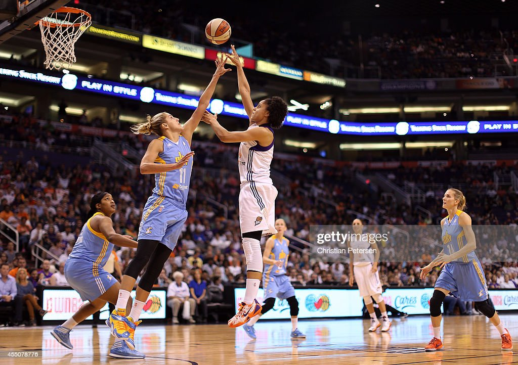 <a gi-track='captionPersonalityLinkClicked' href=/galleries/search?phrase=Candice+Dupree&family=editorial&specificpeople=537818 ng-click='$event.stopPropagation()'>Candice Dupree</a> #4 of the Phoenix Mercury puts up a shot over <a gi-track='captionPersonalityLinkClicked' href=/galleries/search?phrase=Elena+Delle+Donne&family=editorial&specificpeople=5042380 ng-click='$event.stopPropagation()'>Elena Delle Donne</a> #11 of the Chicago Sky during the first half of game two of the WNBA Finals at US Airways Center on September 9, 2014 in Phoenix, Arizona.