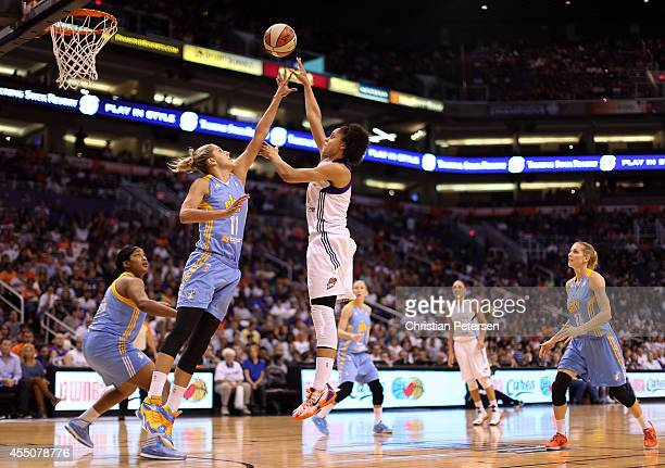 Candice Dupree of the Phoenix Mercury puts up a shot over Elena Delle Donne of the Chicago Sky during the first half of game two of the WNBA Finals...