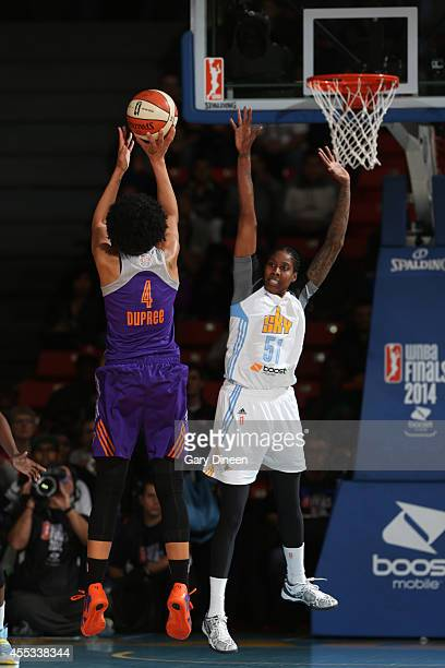 Candice Dupree of the Phoenix Mercury shoots against Jessica Breland of the Chicago Sky in Game Three of the 2014 WNBA Finals on September 12 2014 at...