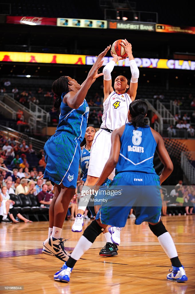 Candice Dupree of the Phoenix Mercury shoots against Nicky Anosike of the Minnesota Lynx in an WNBA game played on June 10 2010 at US Airways Center...