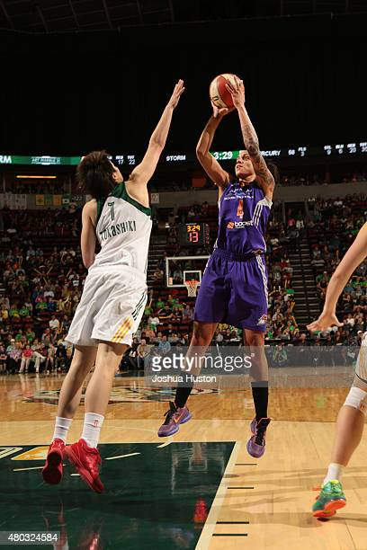 Candice Dupree of the Phoenix Mercury shoots against Ramu Tokashiki of the Seattle Storm during the game on June 25 2015 at KeyArena in Seattle...