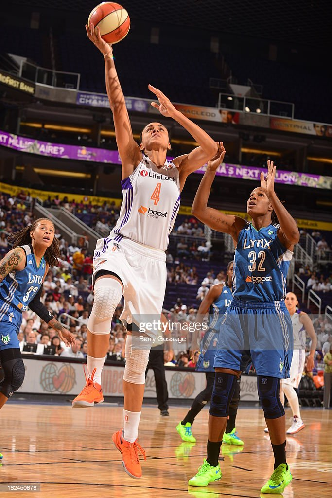 <a gi-track='captionPersonalityLinkClicked' href=/galleries/search?phrase=Candice+Dupree&family=editorial&specificpeople=537818 ng-click='$event.stopPropagation()'>Candice Dupree</a> #4 of the Phoenix Mercury shoots against <a gi-track='captionPersonalityLinkClicked' href=/galleries/search?phrase=Rebekkah+Brunson&family=editorial&specificpeople=213521 ng-click='$event.stopPropagation()'>Rebekkah Brunson</a> #32 of the Minnesota Lynx in Game 2 of the Western Conference Finals during 2013 WNBA Playoffs on September 29, 2013 at U.S. Airways Center in Phoenix, Arizona.