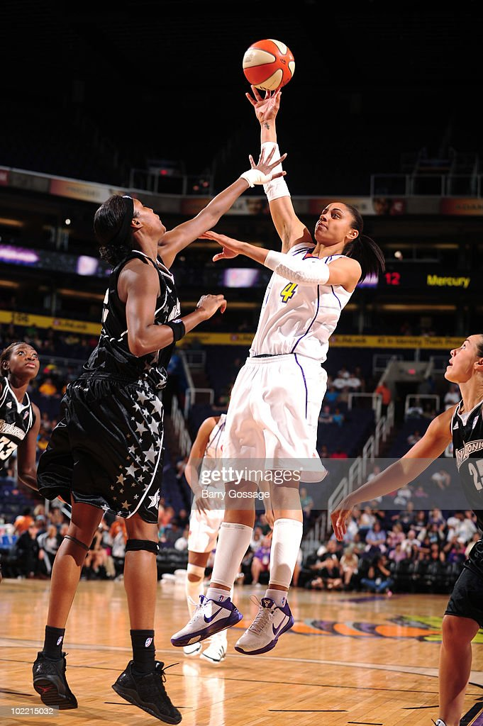 <a gi-track='captionPersonalityLinkClicked' href=/galleries/search?phrase=Candice+Dupree&family=editorial&specificpeople=537818 ng-click='$event.stopPropagation()'>Candice Dupree</a> #4 of the Phoenix Mercury shoots over <a gi-track='captionPersonalityLinkClicked' href=/galleries/search?phrase=Michelle+Snow&family=editorial&specificpeople=208195 ng-click='$event.stopPropagation()'>Michelle Snow</a> #2 of the San Antonio Silver Stars on June 18, 2010 at U.S. Airways Center in Phoenix, Arizona.