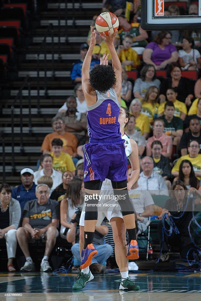 Candice Dupree #4 of the Phoenix Mercury shoots the ball against the Seattle Storm during the game on August 17, 2014 at Key Arena in Seattle, Washington.