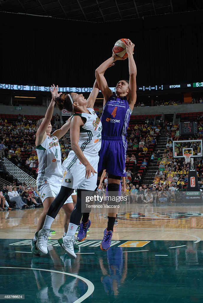 Candice Dupree #4 of the Phoenix Suns shoots the ball against the Seattle Storm during the game on August 17, 2014 at Key Arena in Seattle, Washington.