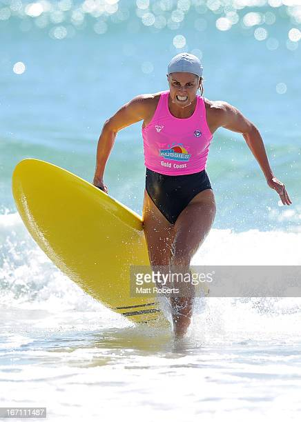 Candice Falzon of Manly SLSC exits the water in the Open Women's Board Race final during the 2013 Australian National Surf Lifesaving Titles on April...
