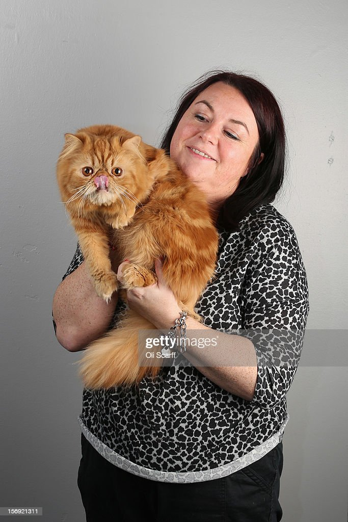 Candice Higgins poses for a photograph with her Red Self Persian cat named 'Saint Elmosfire' after being exhibited at the Governing Council of the Cat Fancy's 'Supreme Championship Cat Show' held in the NEC on November 24, 2012 in Birmingham, England. The one-day Supreme Cat Show is one of the largest cat fancy competitions in Europe with over one thousand cats being exhibited. Exhibitors aim to have their cat named as the show's 'Supreme Exhibit' from the winners of the individual categories of: Persian, Semi-Longhair, British, Foreign, Burmese, Oriental, Siamese.