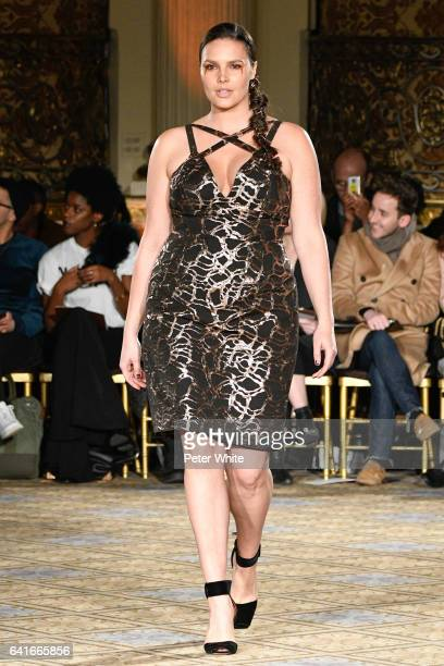 Candice Huffine walks the runway for the Christian Siriano collection during New York Fashion Week at The Plaza Hotel on February 11 2017 in New York...