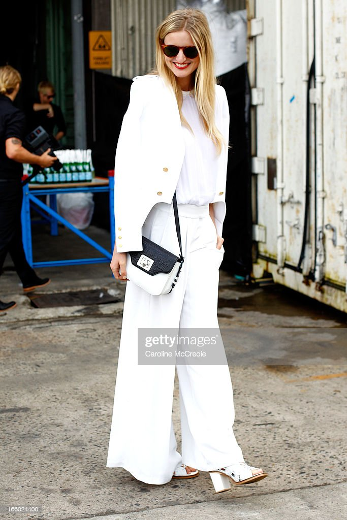 Candice Lake wears an outfit by Camilla and Marc, and carries a bag by Emm Kuo at Mercedes-Benz Fashion Week Australia Spring/Summer 2013/14 at Carriageworks on April 8, 2013 in Sydney, Australia.