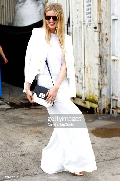 Candice Lake wears an outfit by Camilla and Marc and carries a bag by Emm Kuo at MercedesBenz Fashion Week Australia Spring/Summer 2013/14 at...