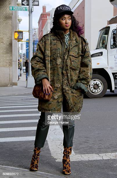 Candice Marie seen at Skylight Clarkson Sq outside the Erin Fetherston show wearing leopard print Topshop boots leather pants camouflage over sized...